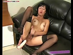 Asian tgirl plays with dildo and her hard dick