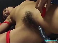 Asian Girl Bondaged Getting Her Hairy Pussy Stimulated And Fucked With Toys By 2 Guys In The Dungeon