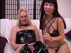 Asian lesbo rides strap on