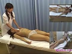 Asian Girl Getting Her Hairy Pussy Fingered By The Masseuse On The Massage Bed